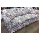 Couch with two accent pillows matching lot 288