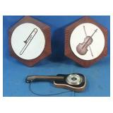Ceramic wall plaques and guitar shaped barometer