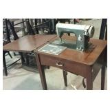 Viking sewing machine in stand with manual
