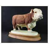 Bull statue on wooden base