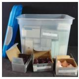 Storage container of assorted candles including