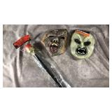 Two masks with royal scepter