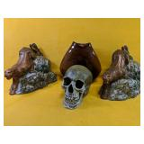 """Two ceramic book ends 10"""", 8"""" base and skeleton"""