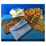 Lot includes Table Cloths, Black Round measures