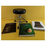 """""""FirstAct"""" adjustable drum stool and three books"""