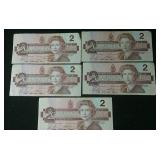 Five 1986 circulated 2 dollar bills