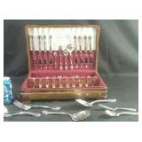 Set of silver plate flatware in case.   Two
