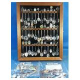Large assortment of collector spoons with wooden