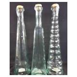 3 glass containers with corks