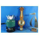 Barometer, metal boat and vintage fondue set