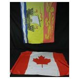 Canadian and New Brunswick flags on poles,