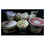 Large assortment of china cups and saucers