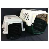 2 plastic pet cages with carrying handles and