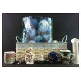 Assorted Christmas decor and mugs with snowflake