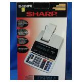 Working Sharp electronic printing calculator