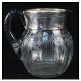 An Art Deco Etched glass and sterling pitcher