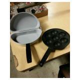Cast iron skillet and omelet maker.