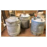 Three vintage fuel cans
