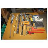 Saws, pipe wrenches, paint stirrer, gun sleeve
