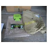box with Khakis, koozies and sunglasses