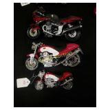 3 toy Moto Guzzi motorcycles.