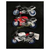 3-Aprilia 1/18th scale toy motorcycles by Maisto.