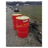 pile of misc: 2 red 55 gallon barrels,