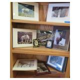 3 shelves of animal pictures, one print