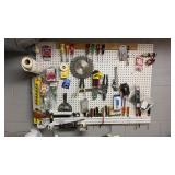 Peg board lot full of miscellaneous tools.