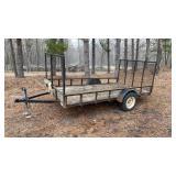 Single axle utility trailer with drop down ramp.