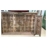 Handmade antique fastener collection display.
