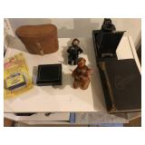 Lot of collectibles to include; old book, camera,