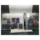 Pokemon cards in album with holos