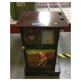 Wood side cabinet w/golf theme and golf clubs