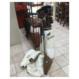 Golf bag w/golf clubs and golfballs picker uppers