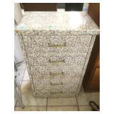 5 drawer fabric covered dresser.