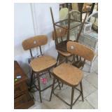 4 vintage barstools with moving backrests.