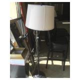 Floor lamp with swivel arm and shade.