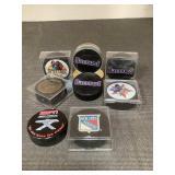 8 hockey pucks no autographs