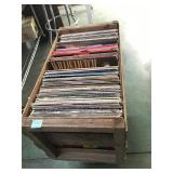 Large wooden crate full of vinyl records
