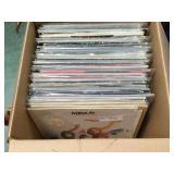 Vinyl records including ABBA, Queen, Kiss, Robin