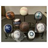 9 baseballs with display