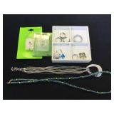 Assortment of fashion jewelry, necklaces, body