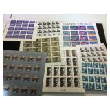 Assortment of unused stamps, $50.40 face value