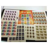 Assortment of unused stamps, $54.30 face value