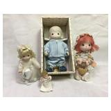 Collection of precious moments dolls