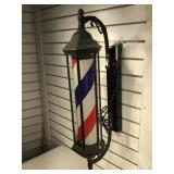 Lighted rotating barber sign