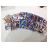 Mixed Sports cards in cases & sleeves with stars