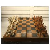 Vintage carved ivory chess set with wooden