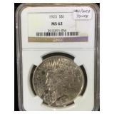 1923  NGC MS62 Leopard Tone Silver Peace Dollar
